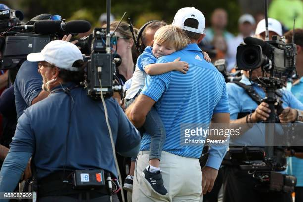 Dustin Johnson celebrates with his son Tatum after winning the World Golf ChampionshipsDell Technologies Match Play at the Austin Country Club on...