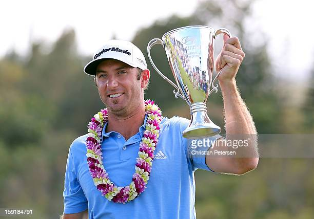 Dustin Johnson celebrates with the Hyundai Tournament of Champions Cup after winning in the final round at the Plantation Course on January 8, 2013...