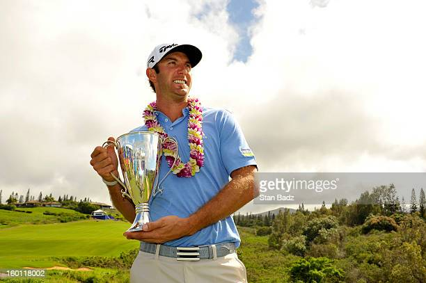 Dustin Johnson celebrates with the Hyundai Tournament of Champions Cup after winning the final round of the Hyundai Tournament of Champions at...