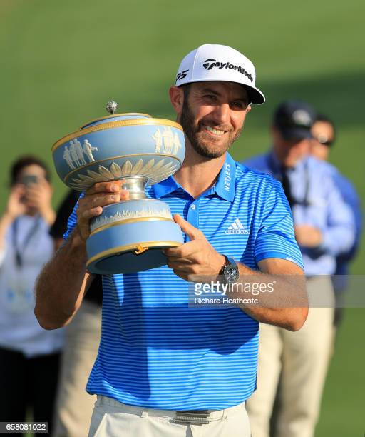 Dustin Johnson celebrates with the trophy after winning the World Golf Championships-Dell Technologies Match Play at the Austin Country Club on March...