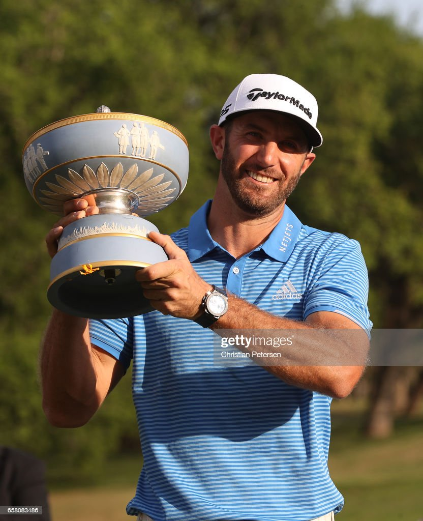 Dustin Johnson celebrates with the trophy after winning the World Golf Championships-Dell Technologies Match Play at the Austin Country Club on March 26, 2017 in Austin, Texas.