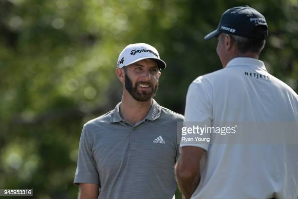 Dustin Johnson chats with Matt Kuchar during the second round of the RBC Heritage at Harbour Town Golf Links on April 13 2018 in Hilton Head South...