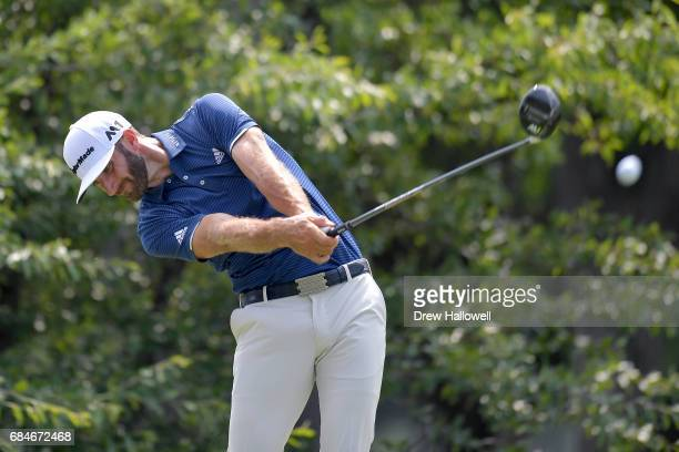Dustin Johnson hits a shot on the 12th tee during Round One of the AT&T Byron Nelson at the TPC Four Seasons Resort Las Colinas on May 18, 2017 in...