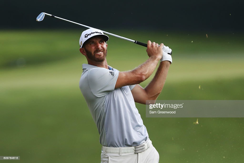 Dustin Johnson hits a shot to the 17th green during the first round of the TOUR Championship By Coca-Cola at East Lake Golf Club on September 22, 2016 in Atlanta, Georgia.