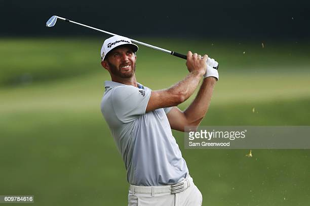 Dustin Johnson hits a shot to the 17th green during the first round of the TOUR Championship By CocaCola at East Lake Golf Club on September 22 2016...
