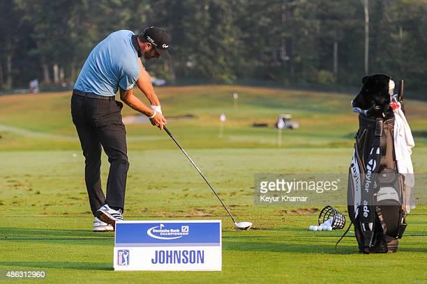 Dustin Johnson hits balls on the range during practice for the Deutsche Bank Championship at TPC Boston on September 3 2015 in Norton Massachusetts