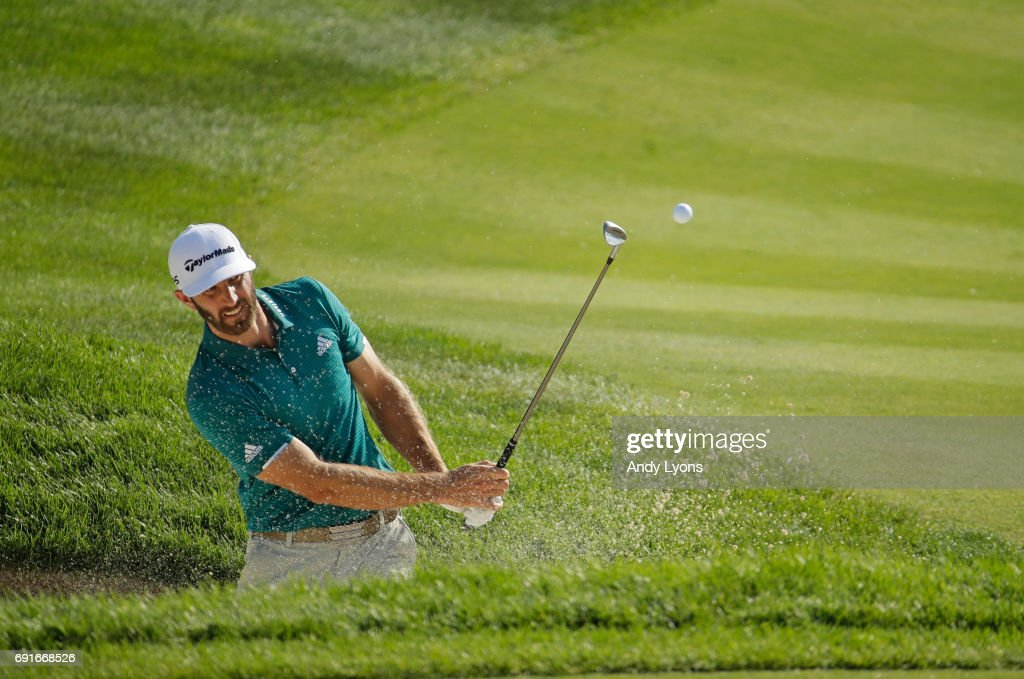 Dustin Johnson hits from a bunker on the 16th hole during the second round of the Memorial Tournament at Muirfield Village Golf Club on June 2, 2017 in Dublin, Ohio.