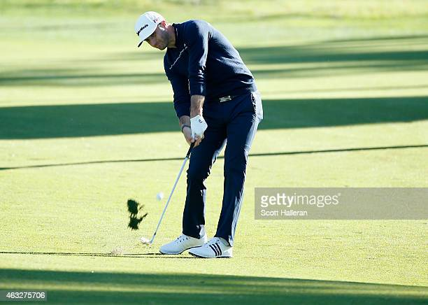 Dustin Johnson hits his approach shot on the fourth hole during the first round of the ATT Pebble Beach National ProAm at Monterey Peninsula Country...