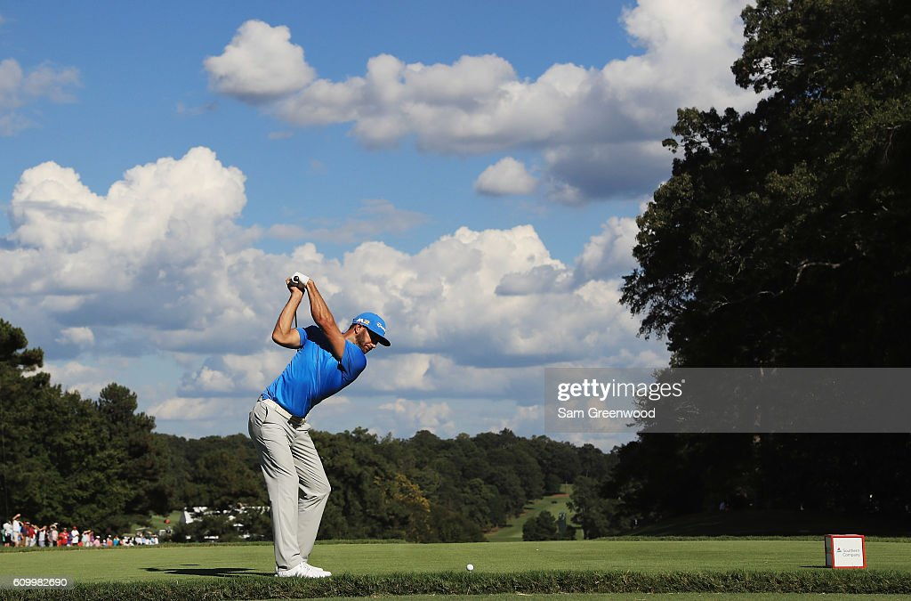 Dustin Johnson hits his tee shot on the 14th hole during the second round of the TOUR Championship at East Lake Golf Club on September 23, 2016 in Atlanta, Georgia.