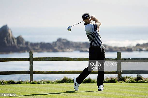 Dustin Johnson hits his tee shot on the 18th hole during the third round of the ATT Pebble Beach National ProAm at the Pebble Beach Golf Links on...