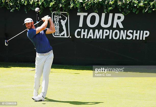 Dustin Johnson hits his tee shot on the first hole during the final round of the TOUR Championship at East Lake Golf Club on September 25 2016 in...