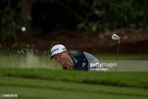 Dustin Johnson hitting out the the sand on on the sixth green during round two of the TOUR Championship at East Lake Golf Club on August 23, 2019.