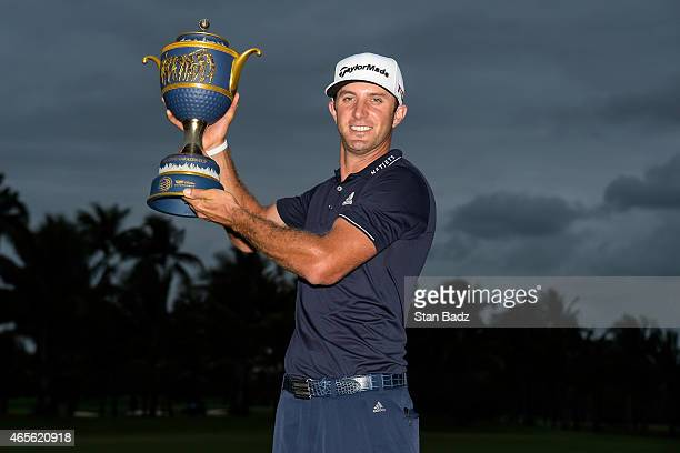 Dustin Johnson holds the Gene Sarazen Cup trophy following his one stroke victory in the final round of the World Golf ChampionshipsCadillac...