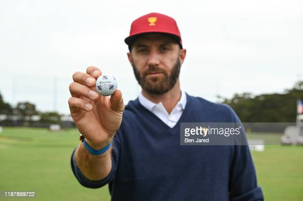 Dustin Johnson holds up a U.S. Team TaylorMade golf ball in his hand prior to Presidents Cup at The Royal Melbourne Golf Club on December 10 in...