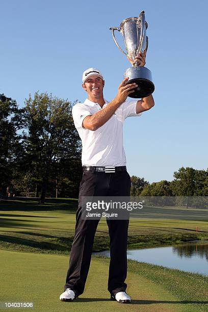Dustin Johnson holds up the Western Golf Association trophy after winning the BMW Championship at Cog Hill Golf Country Club on September 12 2010 in...