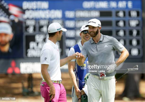 Dustin Johnson is congratulated by Wesley Bryan after getting up and down for par on the seventh hole during the second round of the 2018 RBC...
