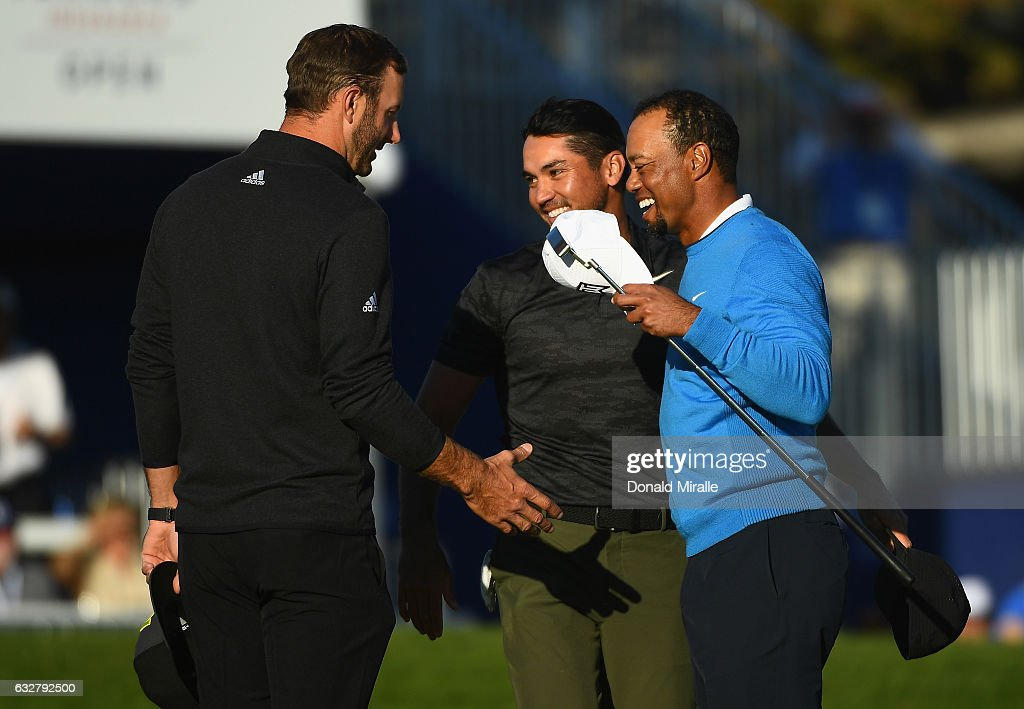 Dustin Johnson, Jason Day of Australia and Tiger Woods shake hands after their round on the 18th hole during the first round of the Farmers Insurance Open at Torrey Pines South on January 26, 2017 in San Diego, California.