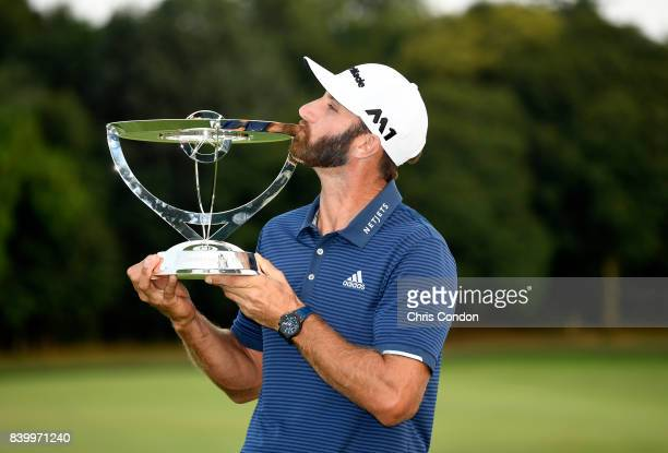 Dustin Johnson kisses the trophy after winning THE NORTHERN TRUST at Glen Oaks Club on August 27 in Old Westbury New York