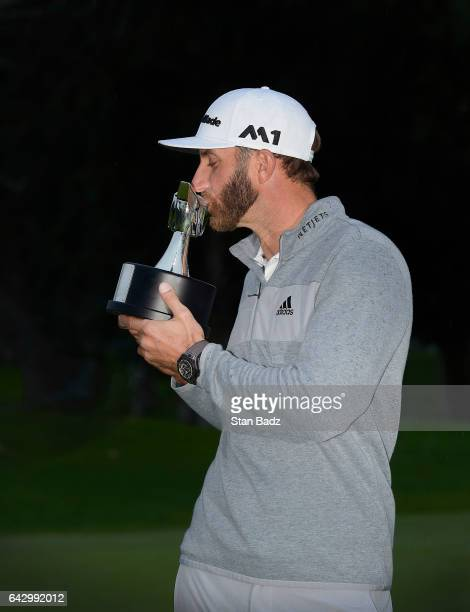 Dustin Johnson kisses the winner's trophy during the final round of the Genesis Open at Riviera Country Club on February 19 2017 in Pacific Palisades...