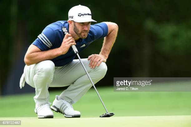 Dustin Johnson lines up a putt on the 11th green during round three of the Wells Fargo Championship at Eagle Point Golf Club on May 6 2017 in...