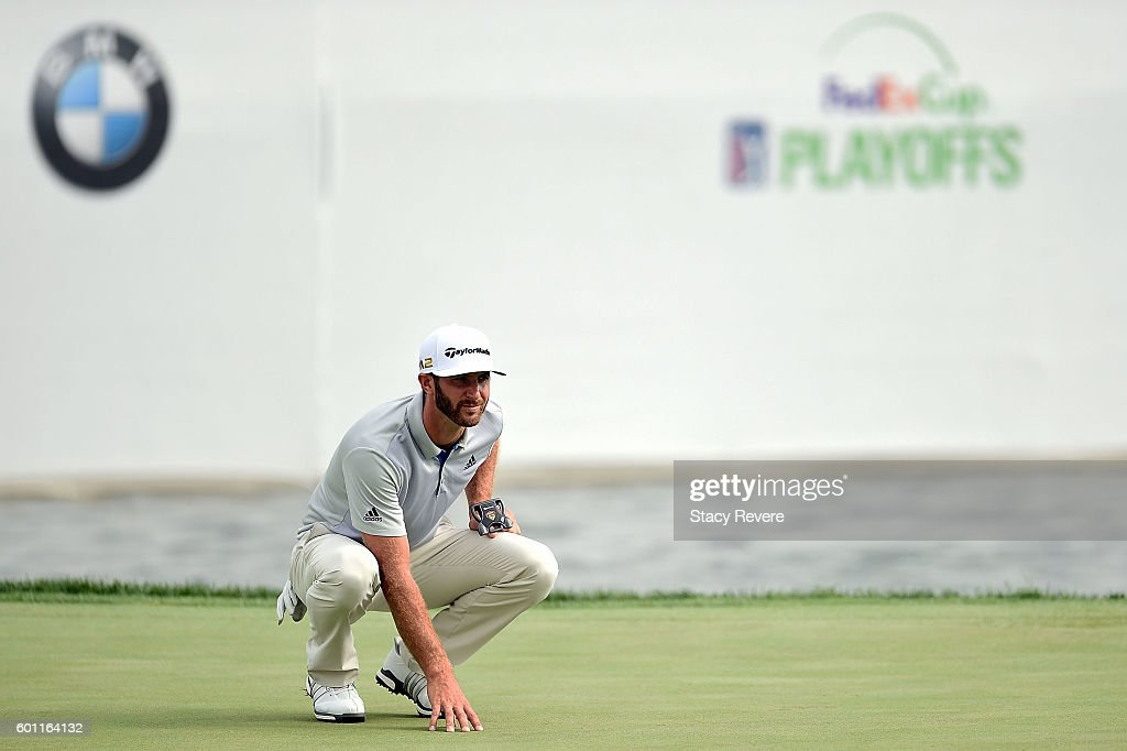Dustin Johnson lines up a putt on the 18th green during the second round of the BMW Championship at Crooked Stick Golf Club on September 9, 2016 in Carmel, Indiana.