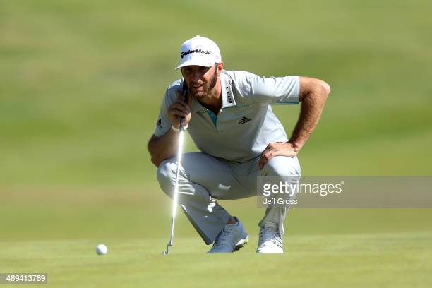 Dustin Johnson lines up a putt on the 2nd hole in the second round of the Northern Trust Open at the Riviera Country Club on February 14, 2014 in...