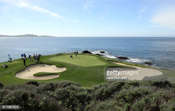 Dustin Johnson lines up a putt on the seventh green during the Final Round of the ATT Pebble Beach ProAm at Pebble Beach Golf Links on February 11...