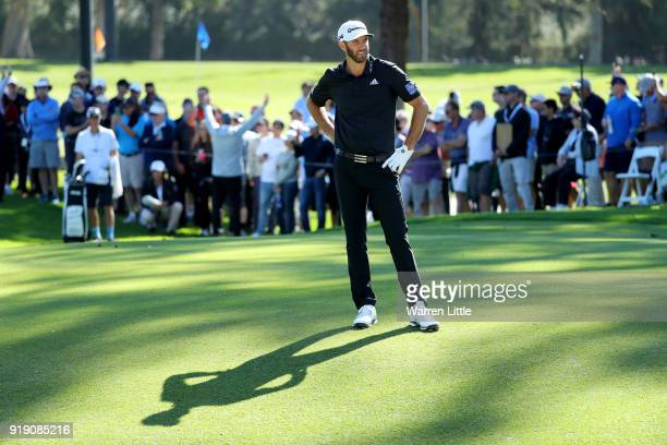 Dustin Johnson lines up a shot on the second hole during the second round of the Genesis Open at Riviera Country Club on February 16 2018 in Pacific...