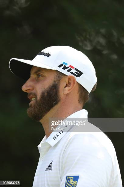Dustin Johnson looks on at the 11th green during the first round of World Golf ChampionshipsMexico Championship at Club de Golf Chapultepec on March...