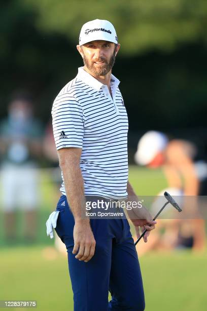 Dustin Johnson looks towards the scoreboard on the 18th green during the third round of the TOUR Championship on September 6, 2020 at East Lake Golf...