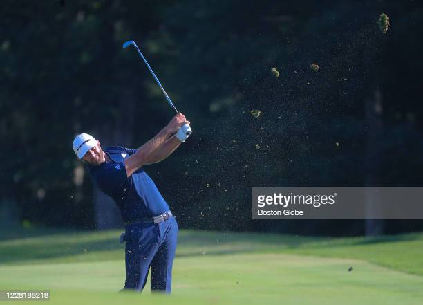 Dustin Johnson makes a second shot fairway iron on the 10th hole during the final round of the Northern Trust PGA Tour playoff tournament at TPC...