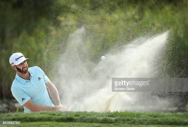 Dustin Johnson makes his first attempt from the sand trap on the 10th hole during the second round of the Dell Technologies Championship at the TPC...