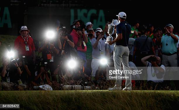 Dustin Johnson Mark Dinham of the United States poses with the winner's trophy after winning the US Open at Oakmont Country Club on June 19 2016 in...
