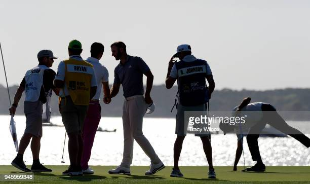 Dustin Johnson Matt Kuchar and Wesley Bryan shake hands after the second round of the RBC Heritage at Harbour Town Golf Links on April 13 2018 in...