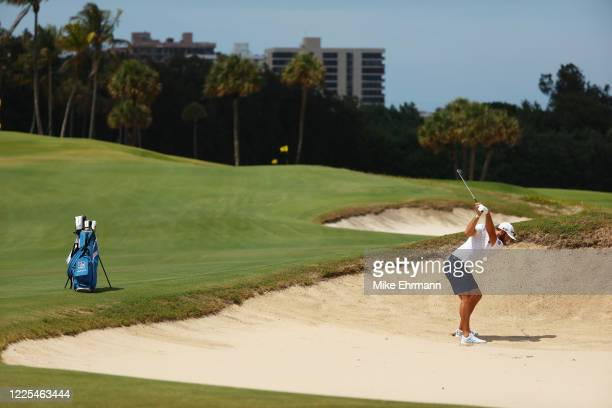 Dustin Johnson of the American Nurses Foundation team plays a shot from a bunker on the fourth hole during the TaylorMade Driving Relief Supported By...
