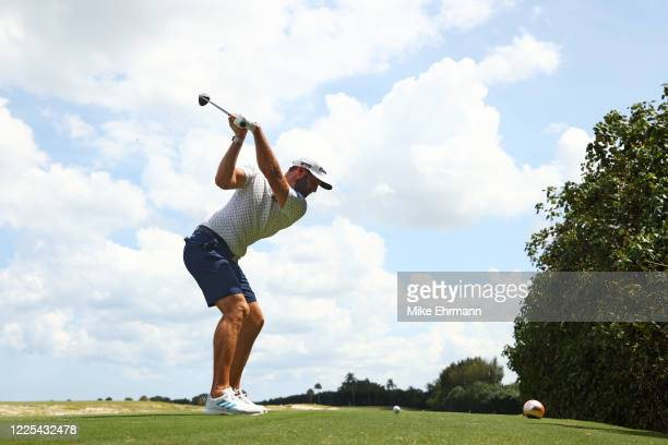 Dustin Johnson of the American Nurses Foundation team plays his shot from the fifth tee during the TaylorMade Driving Relief Supported By...