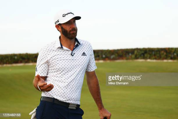 Dustin Johnson of the American Nurses Foundation team reacts after he and Rory McIlroy of the American Nurses Foundation team defeated Matthew Wolff...