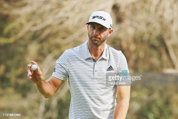 Dustin Johnson of the United States acknowledges the crowd on the 14th green during the third round of World Golf ChampionshipsMexico Championship at...