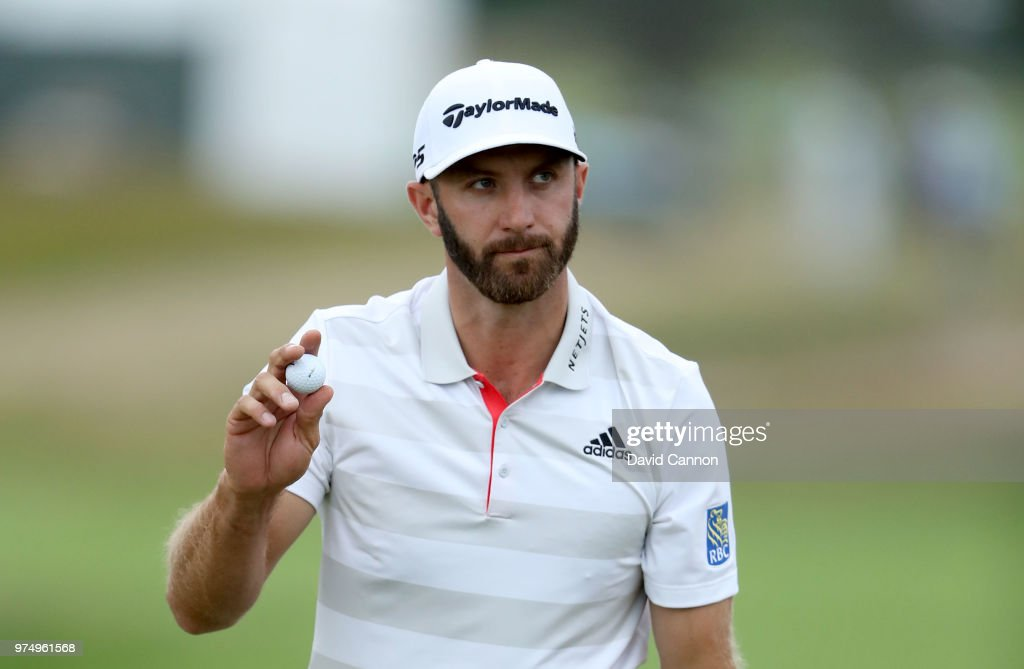 Dustin Johnson of the United States acknowledges the crowds after holing out for par on the 16th hole during the first round of the 2018 US Open at Shinnecock Hills Golf Club on June 14, 2018 in Southampton, New York.