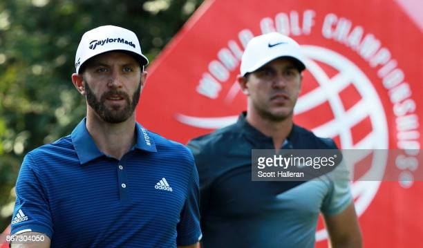 Dustin Johnson of the United States and Brooks Koepka of the United States walk from the 13th tee during the third round of the WGC HSBC Champions at...