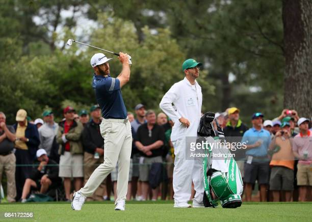 Dustin Johnson of the United States and caddie/brother Austin Johnson on the 14th hole during a practice round prior to the start of the 2017 Masters...