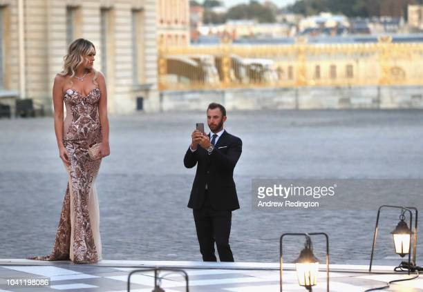 Dustin Johnson of the United States and his partner Paulina Gretzky arrive at the Ryder Cup Gala dinner at the Palace of Versailles ahead of the 2018...