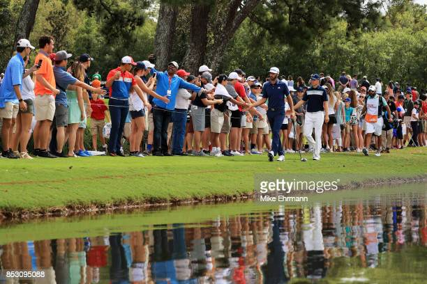 Dustin Johnson of the United States and Jordan Spieth of the United States walk on the eighth hole during the final round of the TOUR Championship at...