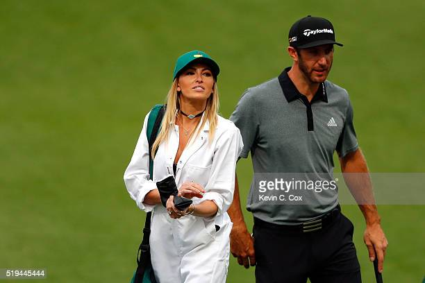 Dustin Johnson of the United States and Paulina Gretzky attend the Par 3 Contest prior to the start of the 2016 Masters Tournament at Augusta...