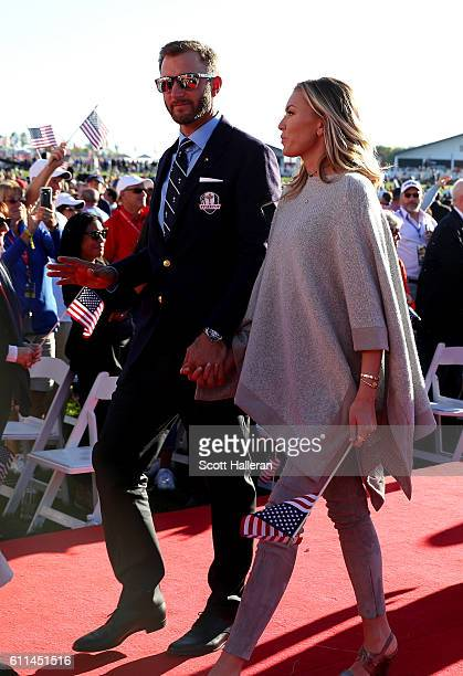 Dustin Johnson of the United States and Paulina Gretzky depart during the 2016 Ryder Cup Opening Ceremony at Hazeltine National Golf Club on...