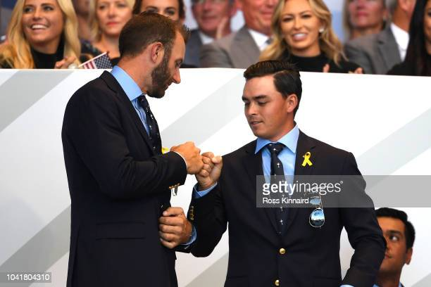 Dustin Johnson of the United States and Rickie Fowler of the United States react after being matched against Rory McIlroy of Europe and Thorbjorn...