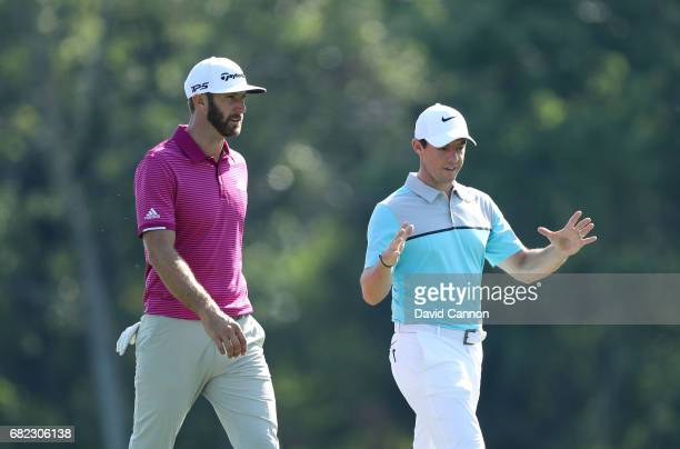 Dustin Johnson of the United States and Rory McIlroy of Northern Ireland on the 14th hole during the second round of THE PLAYERS Championship on the...