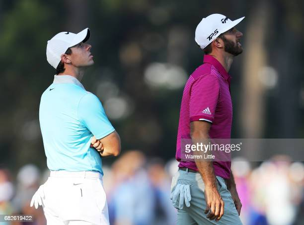 Dustin Johnson of the United States and Rory McIlroy of Northern Ireland look to the sky on the 10th hole during the second round of THE PLAYERS...