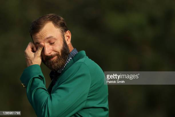 Dustin Johnson of the United States becomes emotional as he is interviewed during the Green Jacket Ceremony after winning the Masters at Augusta...