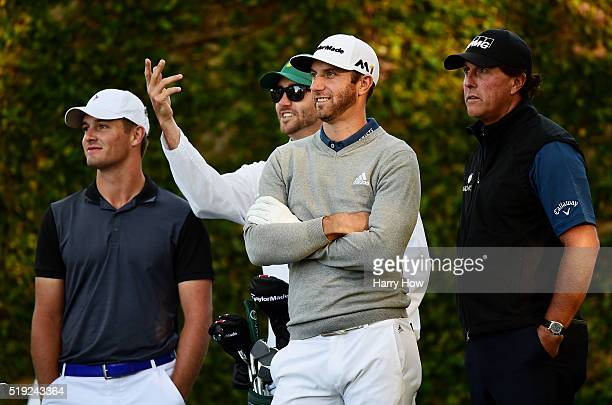 Dustin Johnson of the United States Bryson DeChambeau of the United States and Phil Mickelson of the United States stand on the second tee during a...